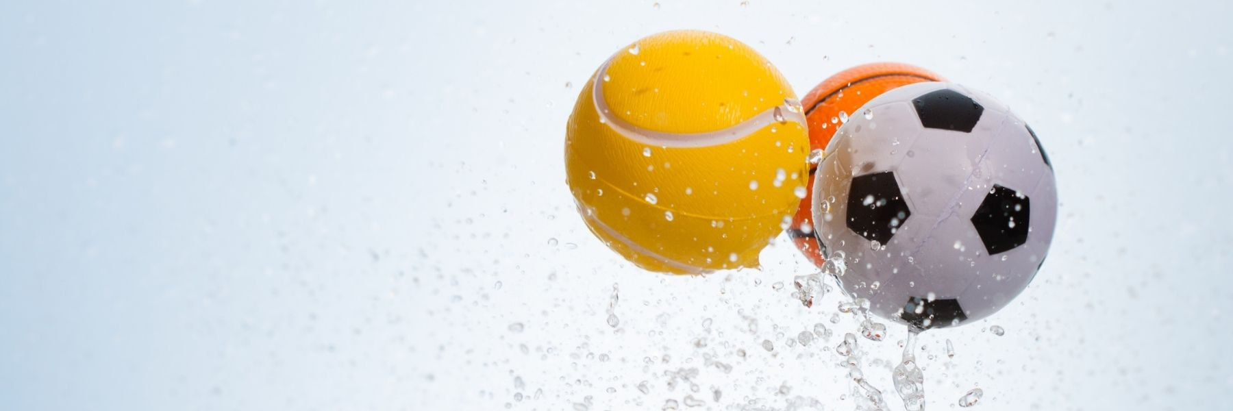 Balls bouncing and trailing water drops