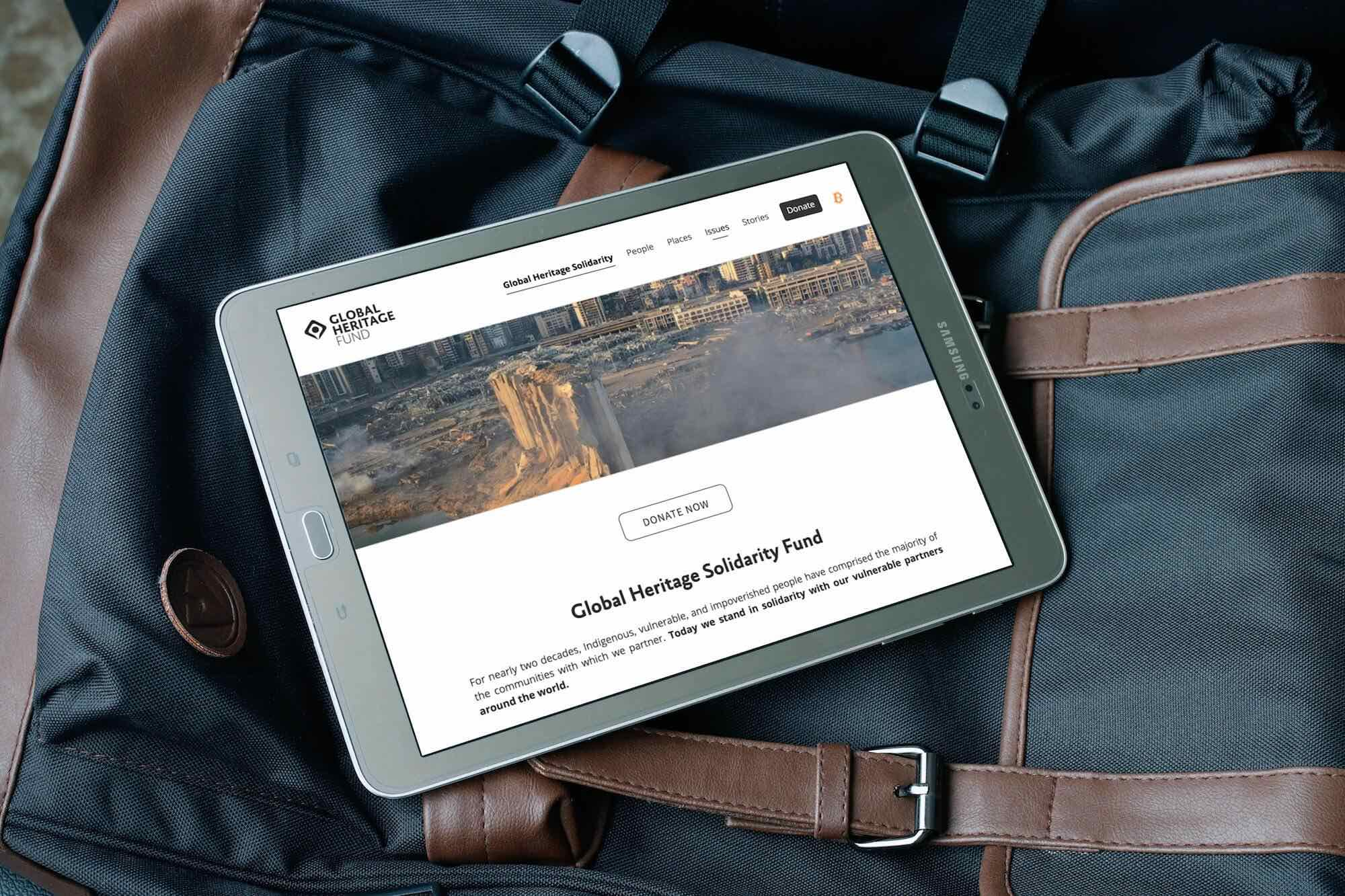 Tablet showing webpage from Global Heritage Fund website.