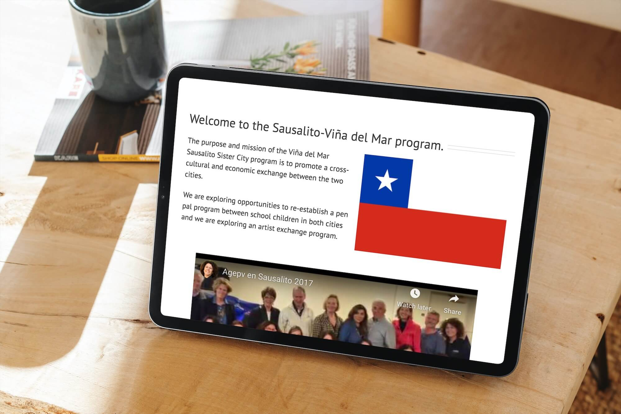 Tablet showing webpage from sausalito sister cities website.