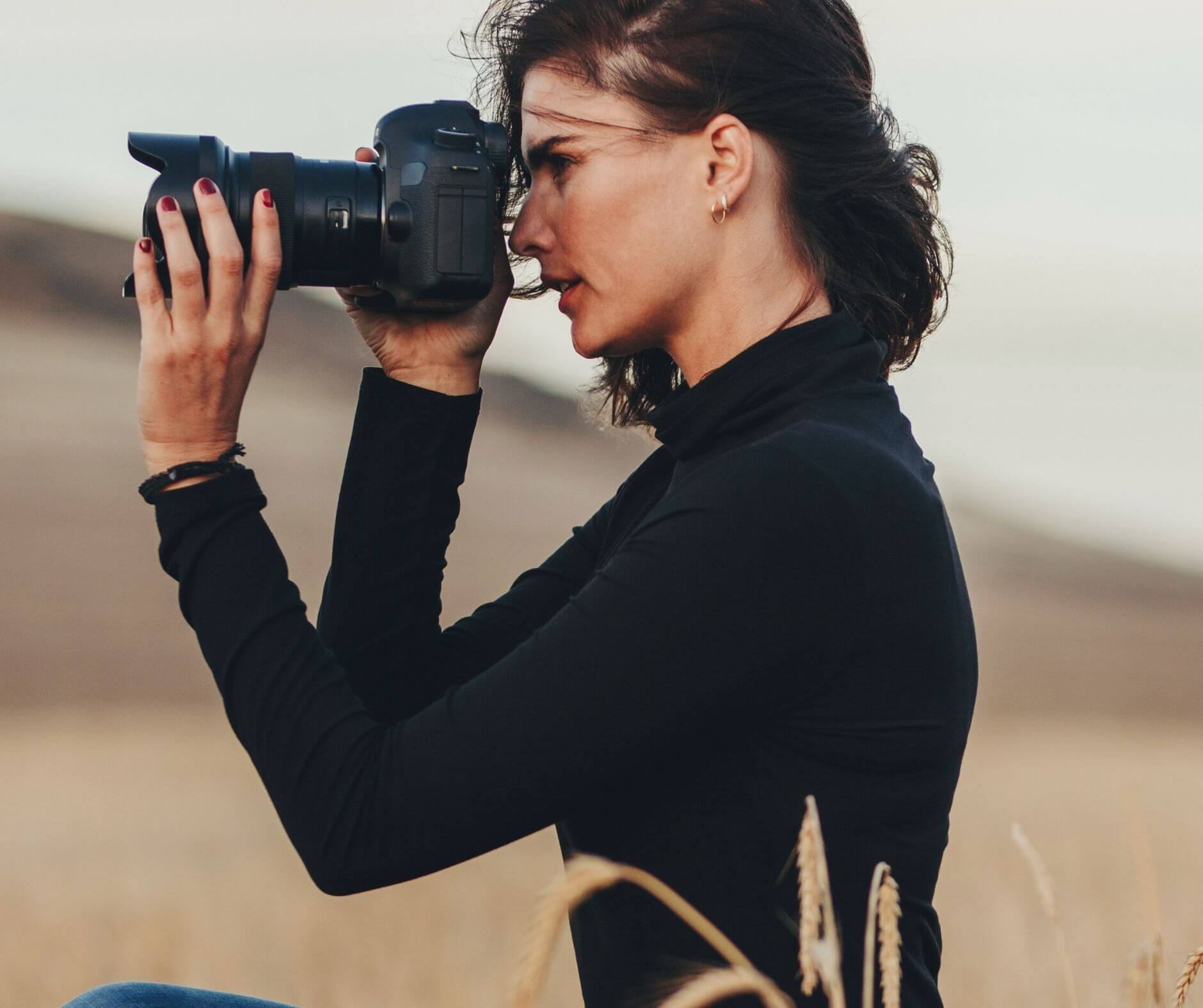 Photographer taking pictures for her website